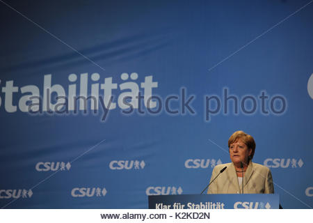 A determined look on Angela Merkel's face as she views a large crowd on the campaign trail in the run up to the - Stock Photo