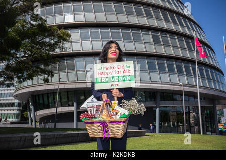 London, UK. 31st August, 2017. PETA protest outside City Hall. Asifa Lahore, Britain's first out Muslim drag queen, poses for photos with a hamper of vegan goodies from PETA before delivering them to London Mayor Sadiq Khan's office for Eid al-Adha holy celebration. Credit: Guy Corbishley/Alamy Live News