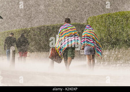Bournemouth, Dorset, UK. 31st Aug, 2017. UK Weather. Visitors getting soaked as torrential rain falls at the seaside - Stock Photo