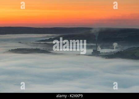 A glorious sunrise over cloud inversion at Hope Valley, Derbyshire, UK. View from Mam Tor, Peak District - Stock Photo