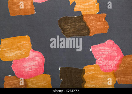 Linen flax fabric with bright colorful abstract pattern in pink and brown colors on gray background. - Stock Photo