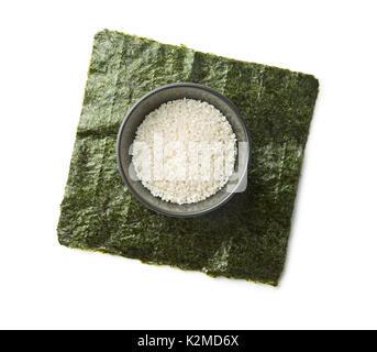 Green nori sheet and rice. Sushi ingredients. - Stock Photo