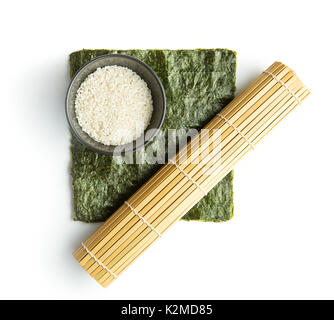Green nori sheet , rice and bamboo mat isolated on white background. Sushi ingredients. - Stock Photo