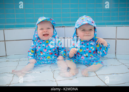 Twin Babies Playing Outside Stock Photo Royalty Free Image 17688824 Alamy