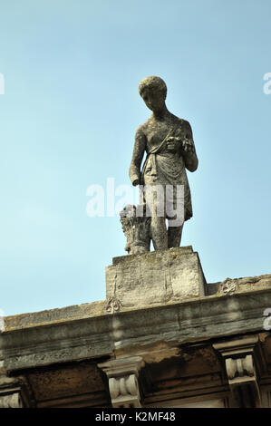 stone statues on the roof of a building faith hope and charity or the four seasons made or sculpted from stone sculptures - Stock Photo