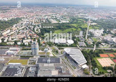 aerial view of Munich, Germany with BMW World, Headquarters and Museum, Am Riesenfeld, in the foreground - Stock Photo