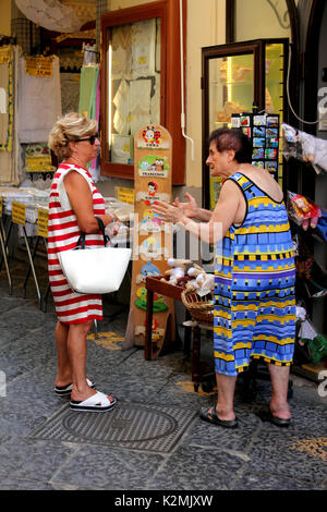 Two Women talking in street Sorrento Amalfi Coast Italy - Stock Photo