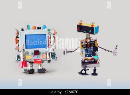Cyber crime concept. IT specialist robot serviceman with screwdrivers looking at colorful computer. Alert warning - Stock Photo