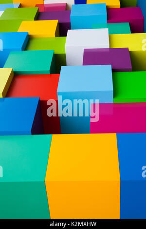 Abstract colorful geometric background. Yellow green  blue red pink white blocks colored edge shapes. Vertical photo. - Stock Photo