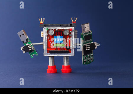 Backup information concept. Robot with portable devices usb flash stick. Macro view, blue background - Stock Photo