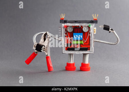 Worker ready for job. Serviceman robot character with red pliers. gray background - Stock Photo