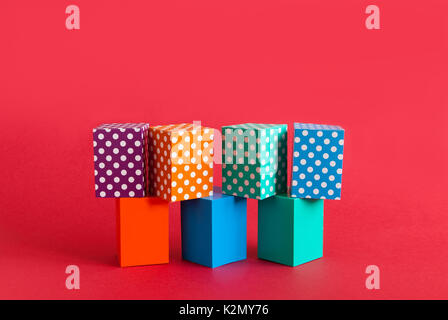 Polka dots pattern boxes abstract colorful on green orange blue blocks. Seamless design geometrical objects, red - Stock Photo