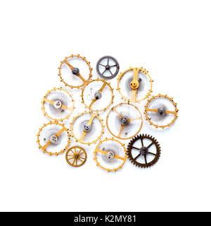 Cogwheels gears steampunk machinery ornament isolated on white. Vintage technology parts closeup. Abstract shape - Stock Photo