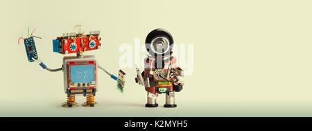 Robotic maintenance repair fix concept. Handyman robots, smiley red head, chip usb flash stick. Mechanic cyborg - Stock Photo