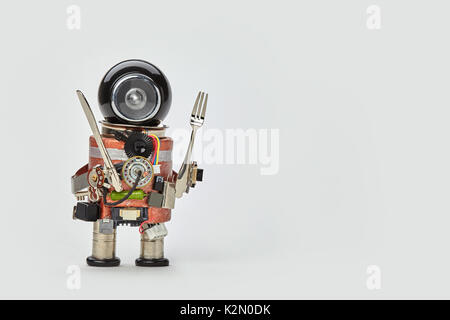 Cooking kitchen chef character with fork and knife in arms. Food menu concept with friendly robot, black helmet - Stock Photo