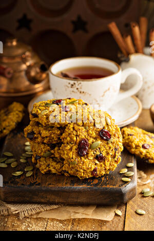 Breakfast oatmeal cookies with pumpkin puree, cranberry and seeds - Stock Photo