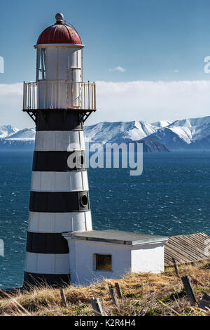 Petropavlovsky Lighthouse (founded in 1850) is located on Mayachny Cape on Kamchatka Peninsula on shore of picturesque - Stock Photo