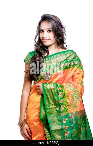 Happy young beautiful traditional Indian woman in traditional saree - Stock Photo