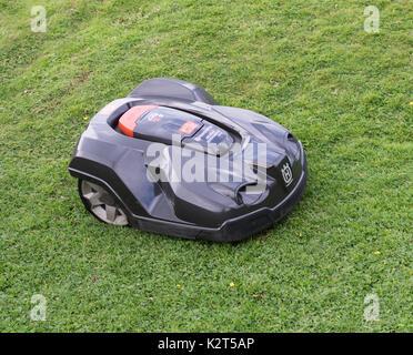 Husqvarna Automower, or robot mower, cutting grass - Stock Photo