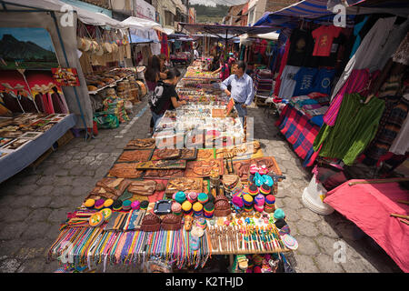 April 29, 2017 Otavalo, Ecuador: indigenous quechua people selling artisan gifts on stands set up on the street - Stock Photo