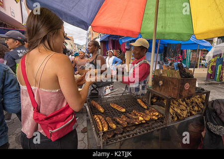 April 29, 2017 Otavalo, Ecuador: plaintains baked on wood fire are popular food with locals as well as tourists - Stock Photo