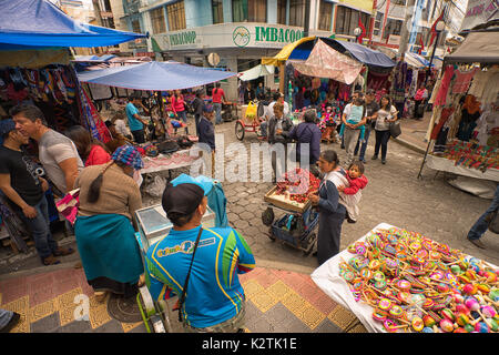 April 29, 2017 Otavalo, Ecuador: street view of the popular weekly artisan market held every Saturday in the indigenous - Stock Photo