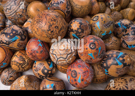 April 29, 2017 Otavalo, Ecuador: indigenous quechua crafts made of coconut shell  selling on the street in the Saturday - Stock Photo