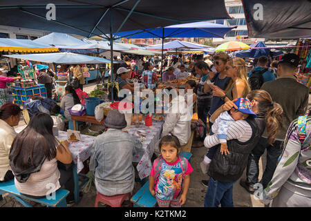 April 29, 2017 Otavalo, Ecuador: makeshift food stands equally popular with locals and tourists on the street in - Stock Photo