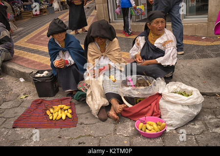 April 29, 2017 Otavalo, Ecuador: indigenous quechua people selling prduce from the ground on the street in the Saturday - Stock Photo