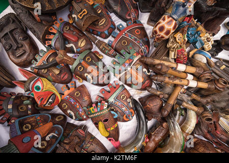 April 29, 2017 Otavalo, Ecuador: indigenous quechua face masks made of wood  selling on the street in the Saturday - Stock Photo