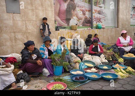 May 6, 2017 Otavalo, Ecuador: produce vendor in the Saturday market selling from street level - Stock Photo