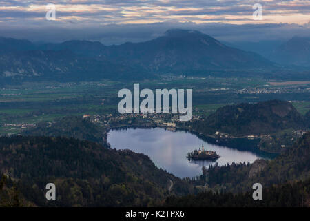 View on Bled lake from the distant hill, which is also a popular paragliding spot. - Stock Photo