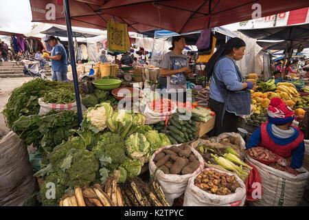 May 6, 2017 Otavalo, Ecuador: produce vendor in the Saturday market - Stock Photo