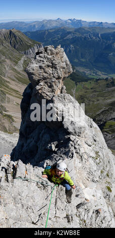 Climbers on the Arete du Doigt on Pointe Percee in the Aravis - Stock Photo