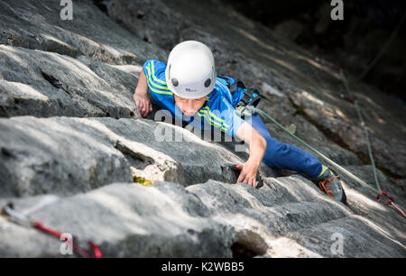 Two people climbing on Arete a Marion in the Aravis mountains, France - Stock Photo