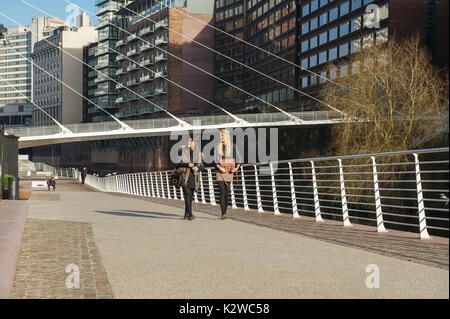 Trinity Bridge and Lowry Hotel on the banks of the River Irwell - Stock Photo