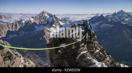 A mountaineer on the shoulder of the Matterhorn - Stock Photo
