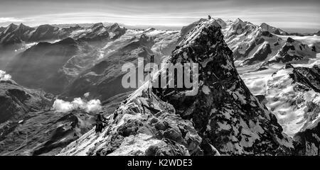 Climbers on the summit of the Matterhorn - Stock Photo