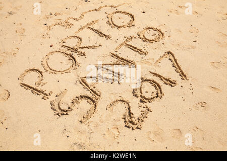 Writings on wet sand. Beach of the island of Porto Santo in the Madeira archipelago, Portugal - Stock Photo