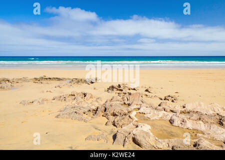 Sandstone rocks on the beach of Porto Santo, island in the Madeira archipelago - Stock Photo