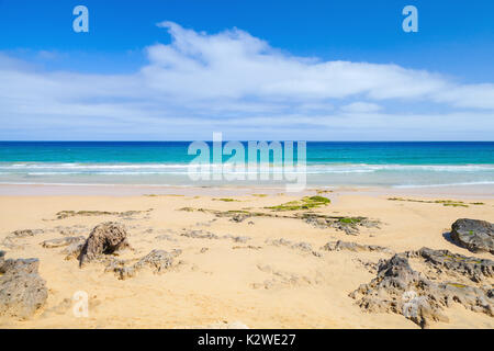 Coastal rocks on the beach of Porto Santo, island in the Madeira archipelago - Stock Photo