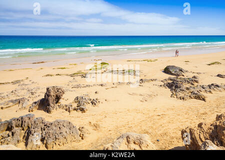 Coastal rocks on sandy beach of Porto Santo, island in the Madeira archipelago - Stock Photo