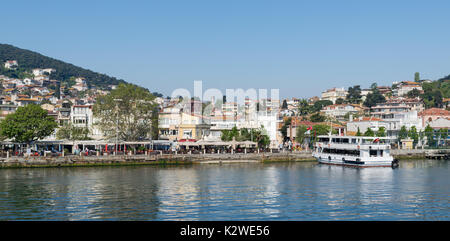 Istanbul, Turkey - April 27, 2017: View of Heybeliada island from the sea with summer houses. the island is the - Stock Photo