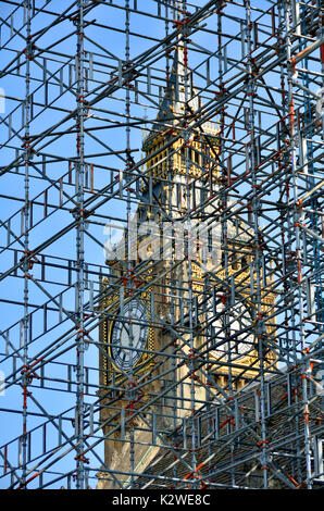 London, England, UK. Big Ben seen through scaffolding during renovation work at the Houses of Parliament (2017) - Stock Photo