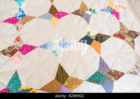 garment industry, applique, creativity. perfectly lined up and symmetrical applications on old blanket have abstract - Stock Photo