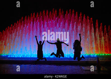 Tourists at Rainbow Fountain at the Magic Water Circuit (world's largest fountain complex), Park of the Reserve, - Stock Photo