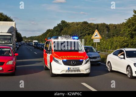 Cars on German motorway leaving a passage for emergency vehicles - Stock Photo