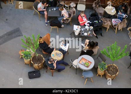 People Sitting at a Sidewalk Cafe, Paris, France. - Stock Photo