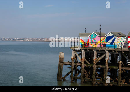 Colourful Beach Huts on Pier at Southend Looking Towards Westcliff-on-Sea - Stock Photo
