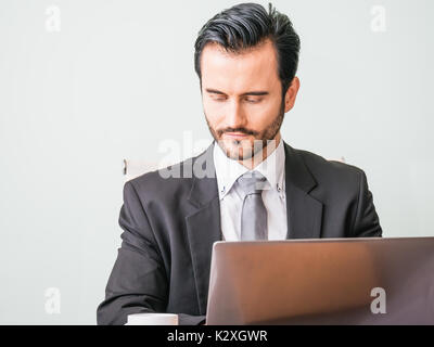 Business Concept - Portrait handsome stressful business man in suit shock looking at work in laptop - Stock Photo